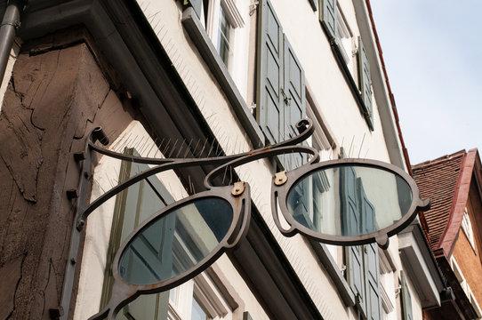 bird control spikes at shop sign of an optician