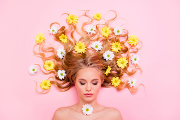 Close up top above high angle view photo beautiful she her lady lying down among flowers long curly wavy hair treatment eyes closed nude inspiration imaginary flight summer isolated pink background