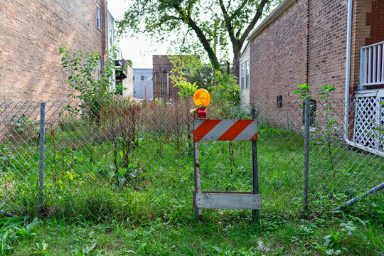Vacant Residential Lot with a Fence and Construction Barrier in Andersonville Chicago
