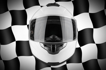 White motorcycle carbon integral crash helmet front of motorsport black and chequered flag background. car kart racing transportation safety concept