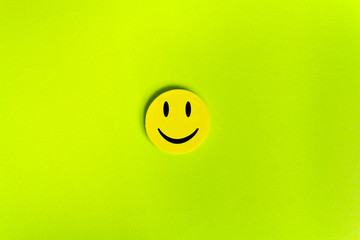Positive Funny smiley face on a green cardboard background. Copy space for advertising and texts