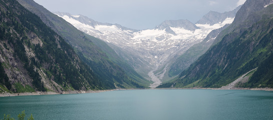Panoramic landscape image of Schlegeis lake and glacier in Tirol, Austria