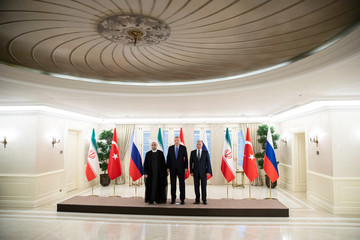 Presidents Hassan Rouhani of Iran, Tayyip Erdogan of Turkey and Vladimir Putin of Russia pose for a picture during their meeting in Ankara