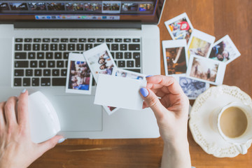 Woman Holding In Hands Instant Photo with place for photo of Your choice
