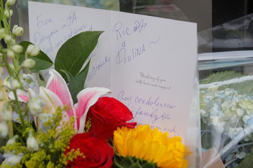 A condolence card and flowers are left at a memorial outside the home of singer and producer Ric Ocasek following his death in New York