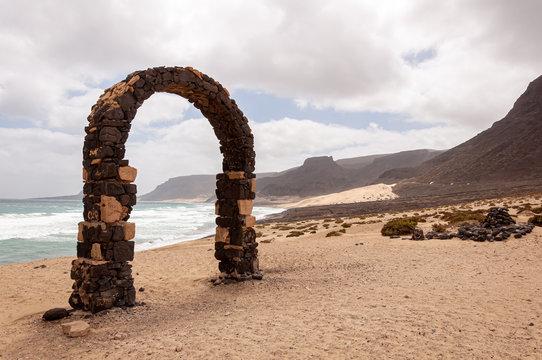 A gateway made of stones at Baia das Gatas bay (Sao Vicente Island, Cape Verde)