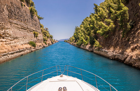 Passing through the Corinth Canal by yacht, Greece. The Corinth Canal connects the Gulf of Corinth with the Saronic Gulf in the Aegean Sea.