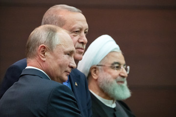 Presidents Hassan Rouhani of Iran, Tayyip Erdogan of Turkey and Vladimir Putin of Russia pose for a picture after a news conference during their meeting in Ankara