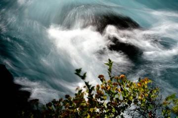 Metolius River swirls near Camp Sherman, Oregon.  Long exposure to highlight the tubulent flow.
