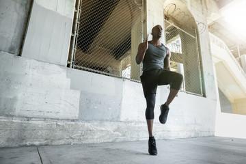 Outdoor cardio exercise routine in city setting, endurance, stamina, determination, inspiration,...