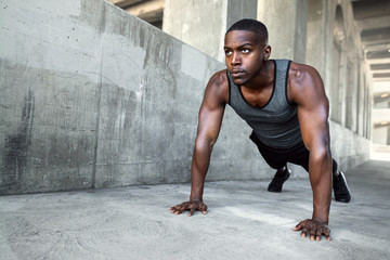 African american male athlete, city urban training, fitness push ups on concrete with copy space