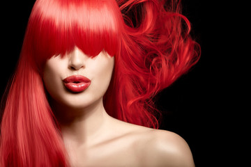 Sensual sexy beauty portrait of a red haired young woman with a healthy long hair