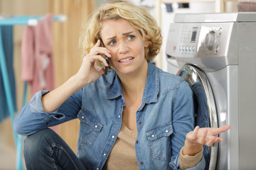worried young woman talking on mobilephone