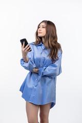 Beautiful Hispanic teen girl holding cell phone