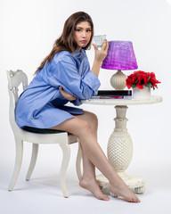 Beautiful Hispanic teen girl sitting at table with coffee