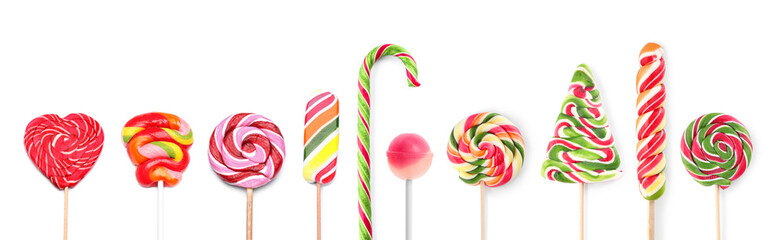 Different tasty lollipops on white background