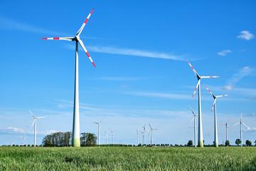 Modern wind energy generators in a cornfield seen in Germany