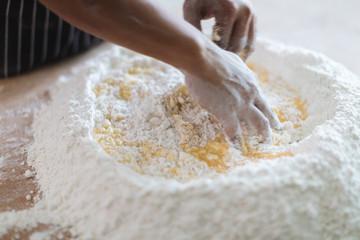 Making Handmade Noodles on wood background