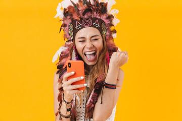 Spoed Fotobehang Carnaval Indian woman in carnival suit using mobile phone.