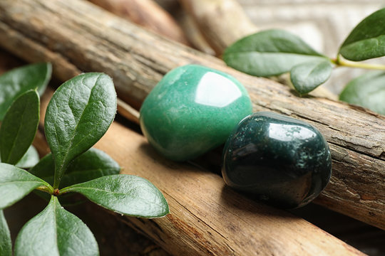 Beautiful green aventurin and heliotrope gemstones with wooden sticks