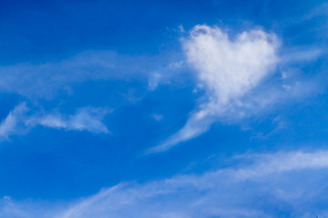 Perfect of real heart shaped from white softy cloud shown on cloudy blue sky. Background for love picture, Valentine day or business target or meteorology or inspiration concept