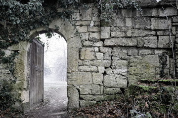 Smal Gate in the Wall of a Medieval Monastery