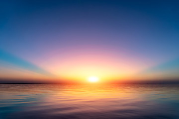 Sunset view above water