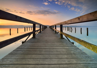Lake with Long Wooden Pier at Sunrise