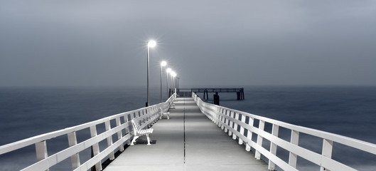 White Pier by the Sea at Dawn, grey moody sky