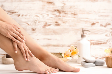 Wall Murals Pedicure Young woman after spa pedicure treatment in beauty salon