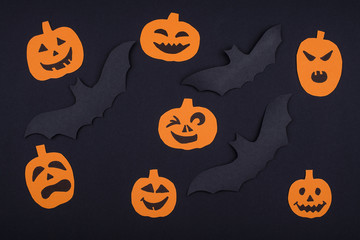 Greetind card for Halloween Party from pumpkins and bats.