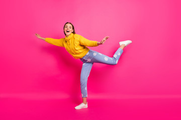 Full length photo of charming youngster screaming raising her arms wearing yellow jumper dotted denim jeans isolated over fuchsia background