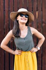 Happy woman in sunglasses enjoying summer