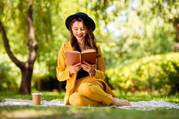 Fototapete - Portrait of her she nice-looking attractive lovely charming pretty trendy cheerful wavy-haired girl sitting on cover veil blanket spending autumn fall reading interesting book on fresh air outdoors