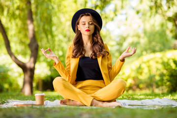Fototapete - Portrait of her she nice-looking attractive lovely pretty calm peaceful focused concentrated wavy-haired girl sitting in lotus position meditating practicing on fresh air outdoors