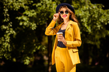 Fototapete - Portrait of her she nice-looking gorgeous glamorous attractive lovely pretty cheerful trendy confident girl drinking coffee spending fall autumn on fresh air in green forest wood outdoors