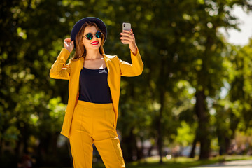 Fototapete - Portrait of her she nice-looking gorgeous attractive lovely pretty cheerful confident trendy fashionable girl taking making selfie on fresh air in green forest wood outdoors