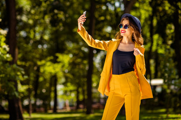 Fototapete - Portrait of her she nice-looking gorgeous attractive lovely charming pretty cheerful cheery confident trendy fashionable girl taking making selfie in green forest wood outdoors