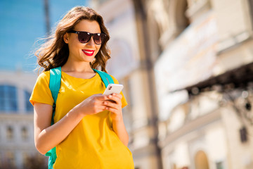 Fototapete - Portrait of her she nice attractive lovely winsome pretty cheerful cheery girl wearing colorful yellow bright t-shirt browsing internet online web service outdoors