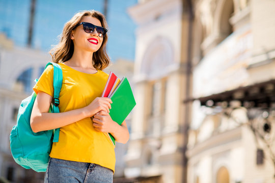 Portrait of her she nice attractive lovely charming dreamy cheerful cheery wavy-haired girl enjoying traveling abroad foreign UK learning language course in downtown center outdoor