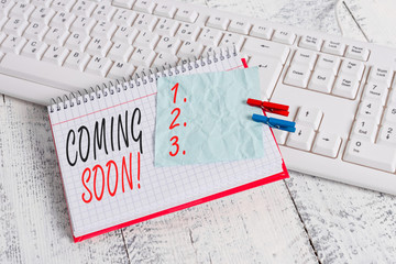 Text sign showing Coming Soon. Business photo showcasing event or action that will happen after really short time notebook paper reminder clothespin pinned sheet white keyboard light wooden