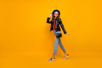 Fototapete - Full size photo of charming content girl enjoying promenade have fun wear black leather look outfit denim jeans isolated over yellow color background