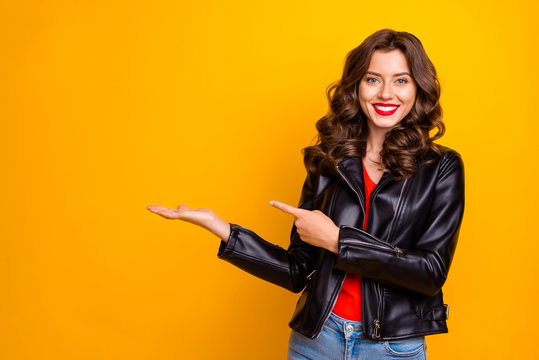 Photo of pretty lady promoter holding on arm best product for final low price wear leather jacket isolated yellow color background