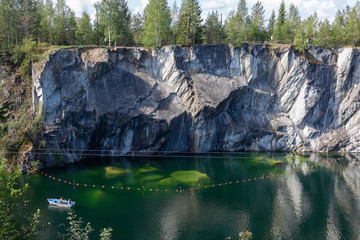 Old deep marble quarry in Ruskeala Mountain Park - today it is a popular tourist attraction, Karelia, Russia