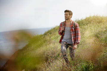 Man walking in country path by the sea