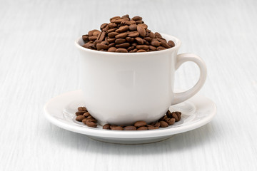 Poster Café en grains Cup full of coffee beans