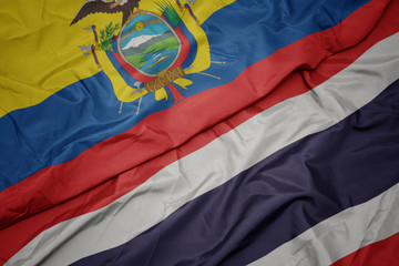 waving colorful flag of thailand and national flag of ecuador.