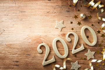 Happy New Year festive background with golden numbers 2020 and Christmas decorations on vintage...