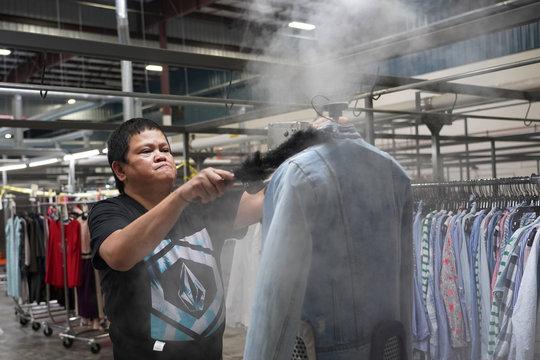 Yolanda Malolos steams a jacket at subscription clothing rental company Le Tote's warehouse in Stockton