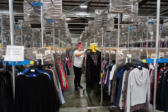 Marcela Rios picks clothes at subscription clothing rental company Le Tote's warehouse in Stockton
